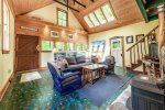 The cottage main living room with cathedral ceilings